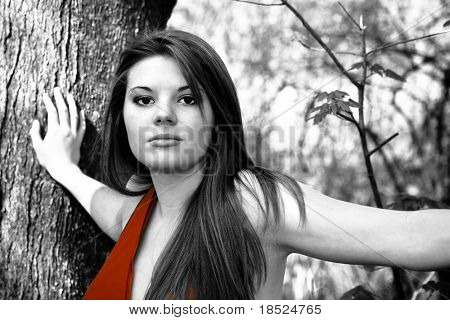 abstract selective color portrait of sultry woman in red dress