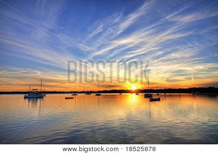 hdr image of sailboats in harbor at sunset