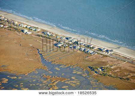 aerial view of waterfront homes on the ocean