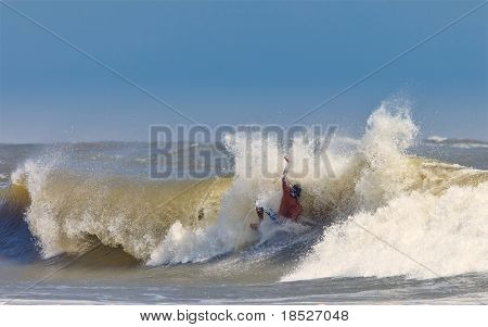 man getting pounded by wave surfing