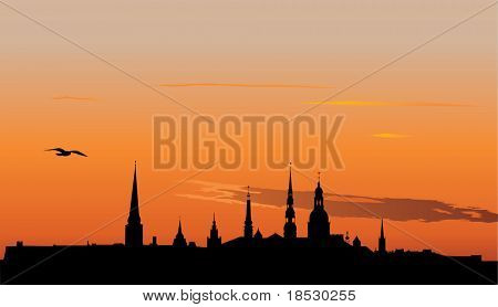 Vector illustration of Old Riga panorama silhouette in sunrise
