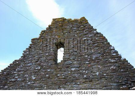 Ancient wall at an old chapel ruin at the swedish island Oland