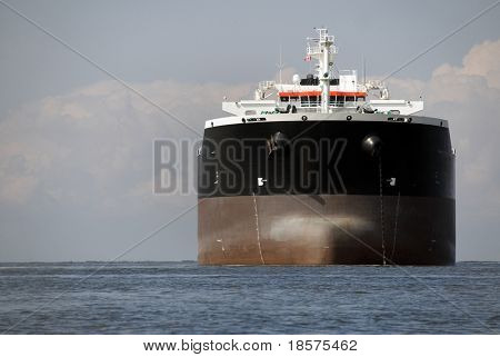 An empty freighter anchored in Canadian waters.