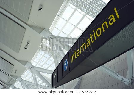 A sign above the international departure gate at a new terminal in a major North American airport.