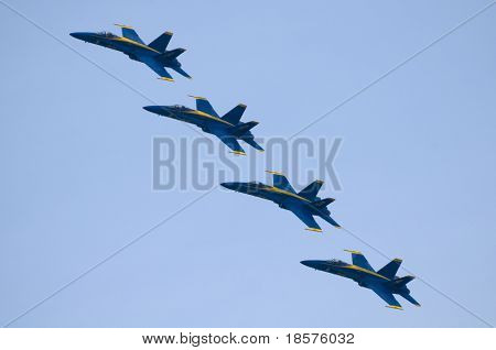 TORONTO, ON - SEPTEMBER 7: Four F/A18 Hornets from the US Navy Blue Angels Flight Demonstration Squadron in formation over the city on the last day of the air show, September 7, 2009 in Toronto, ON.