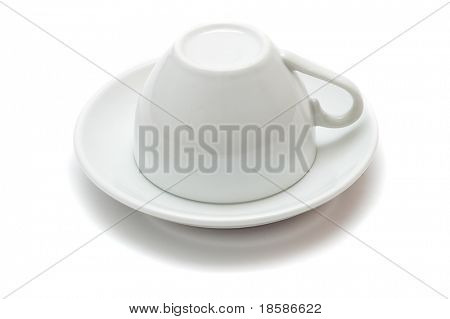 upside-down cup over saucer isolated on white background
