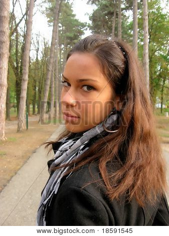 Young girl with black coat in the park