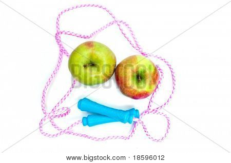 Jump rope and two apples (high angle view)