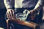 Restaurant Staff Wiping Glass on Table Setting Service for Reception poster