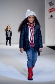 VALENCIA, SPAIN - JANUARY 23: Model Alicia Sanz, age 12, of Valencia on the catwalk for the Valencia