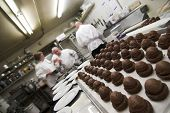 picture of pastry chef  - pastries in a restaurant kitchen with chefs in background - JPG