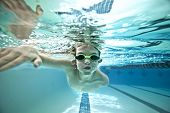 underwater shot of boy swimming laps in pool