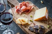 Platter With Spanish Ham Jamon Serrano Or Italian Prosciutto Crudo, Sliced Italian Hard Cheese Pecor poster