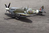 foto of spitfire  - A British Spitfire fighter plane stands ready for action on an oil - JPG