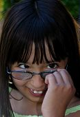 stock photo of nymphet  - Picture of a cute little girl with glasses - JPG