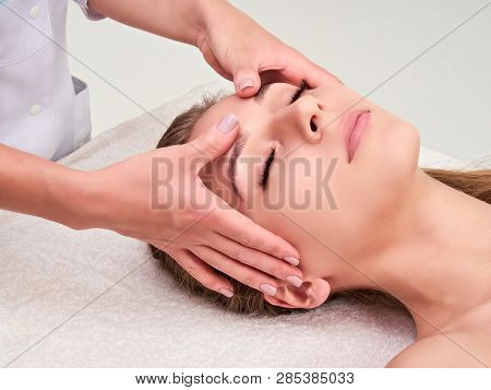 poster of Leisure. Woman In Spa Salon. Massage And Face Care. Spa Face Massage Woman Hands Treatment.