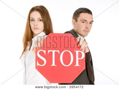 Couple Holding Stop Sign