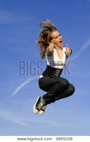 Happy Young Woman Jumping For Joy
