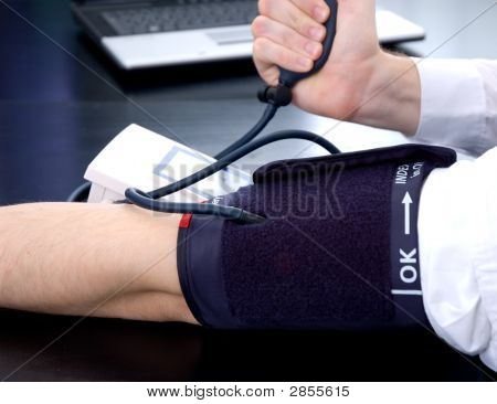 Businessman Measuring His Blood Pressure