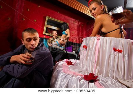 Guy having fun with Sexy Woman popping Out of a Giant Cake