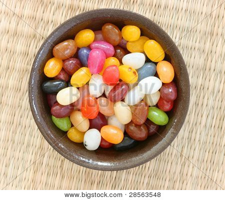 Colourful candies in brown bowl
