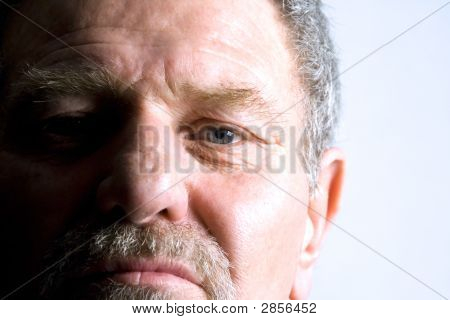 Isolated Close Up On The Face Of An Elder Man