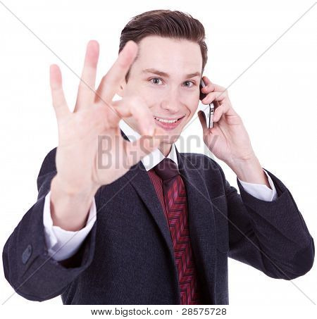 business man on the phone approving the good news over white background