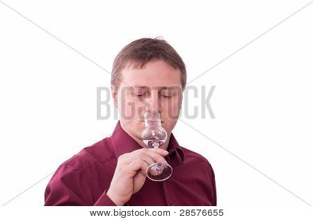 Man Is Savouring A Grappa