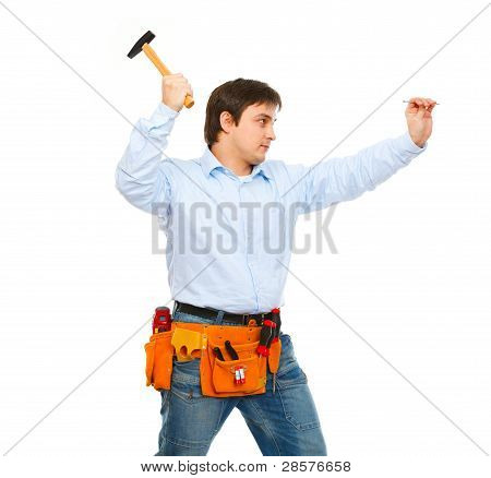 Construction Worker Hammering Nail