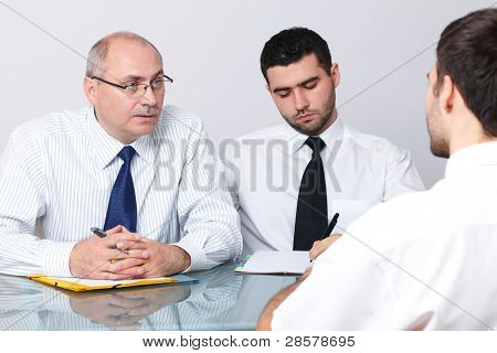 Senior and young colleague interview applicant for a job