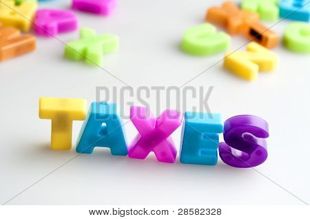 Taxes word made by color letters