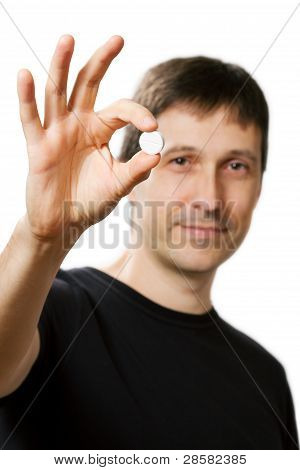Young Man Showing Medical Pill And Giving Ok Hand Sign
