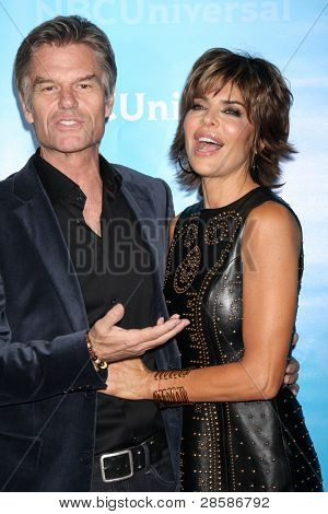 LOS ANGELES - JAN 6:  Harry Hamlin, Lisa Rinna arrives at the NBC Universal All-Star Winter TCA Party at The Athenauem on January 6, 2012 in Pasadena, CA
