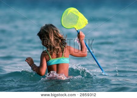 Young Girl Playing In The Water