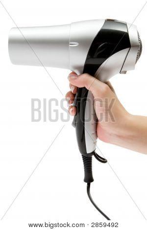 Holding A Hair Drier
