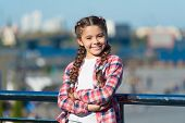Leisure Options. Free Time And Leisure. Girl Cute Kid With Braids Relaxing Urban Background Defocuse poster