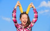 Vegetarian Nutrition Concept. Kid Girl Hold Yellow Corn Cob On Sky Background. Girl Cheerful Hold Ri poster