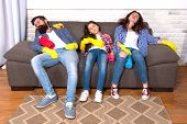 Exhausting Cleaning Day. Family Mom Dad And Daughter With Cleaning Supplies Sit On Couch. Family Car poster