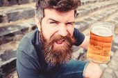 Friday Relax Concept. Man With Beard And Mustache Holds Glass With Beer While Sits On Stone Stairs.  poster