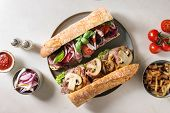 Variety Of Beef Baguette Sandwiches With Champignon Mushrooms, Green Salad, Fried Onion, Tomatoes Se poster