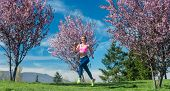Fit woman in spring running or jogging as sport poster