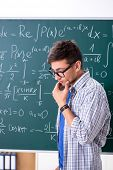 Young male student studying math at school poster