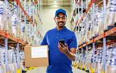 mail service, technology and shipment concept - happy indian delivery man or warehouse worker with s poster