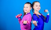 On Way To Stronger Body. Girls Exercising With Dumbbells. Beginner Dumbbells Exercises. Sporty Upbri poster