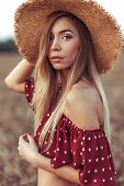 Beautiful And Young Woman Straw Hat In Summer In Field. Concept Village Girl Nature. Emotions Tender poster