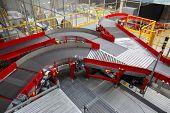 Empty Conveyor Sorting Belt At Distribution Warehouse. Distribution Hub For Sorting Packages And Par poster
