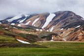 Visitors at the Landmannalaugar, a natural park in the Fjallabak Nature Reserve, famous for colourfu poster