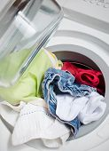 image of washing machine  - washing machine full of colorful clothes to be washed - JPG