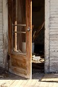 picture of screen-porch  - The porch of an abandoned house with rubble visible on the floor - JPG