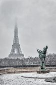 Snowfall Over France Reborn Statue On Pont De Bir-hakeim With Eiffel Tower In Background. poster